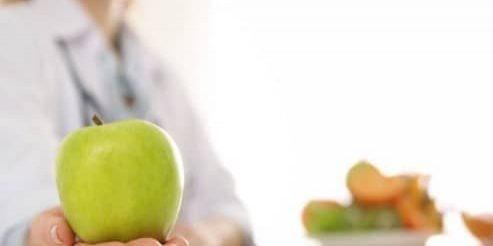 nutritionist-apple-desk-office-closeup